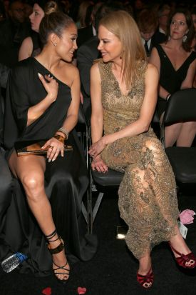 Jennifer Lopez, left, shares a moment with Nicole Kidman at the Grammys.
