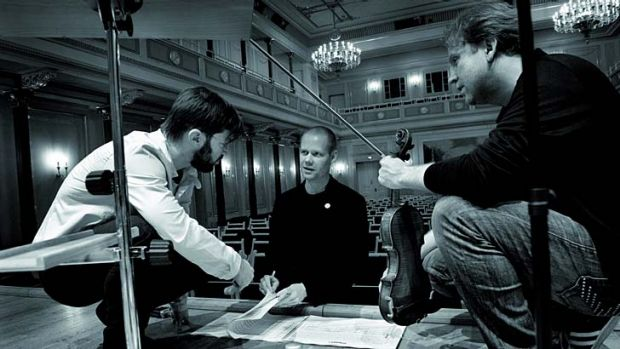 Collaborative spirit ... from left, conductor Andre de Ridder, Max Richter and violinist Daniel Hope.