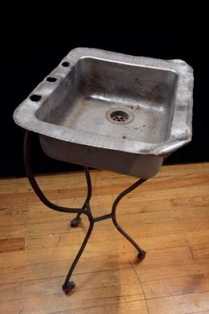 A kitchen sink on a tripod found in a lane and the full suite.
