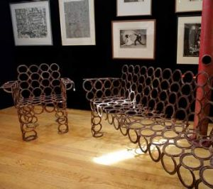 A bench made from horseshoes.