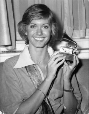 Olivia Newton-John with one of her Grammys for <i>I Honestly Love You</i> in 1975.