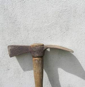Police shot the defendant as he threatened the victim with a mattock.