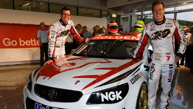 Holden Racing Team drivers Garth Tander (left) and James Courtney unveil the new VF Commodore V8 Supercar.