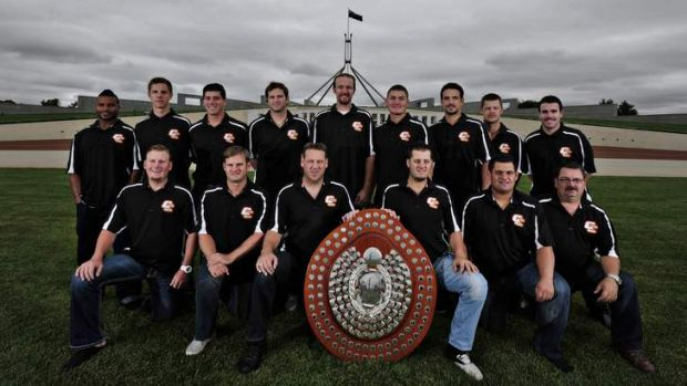 The Canberra Cavalry celebrate their ABL championship win on the lawns of Parliament House.