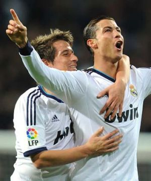 Cristiano Ronaldo celebrates one of his three goals against Sevilla at the weekend with Fabio Coentrao.