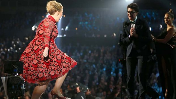 Grammys gatecrasher attempts to intercept Adele's winning moment.