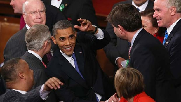 Job done ... US President Barack OBama greets members of Congress after his State of the Union speech.
