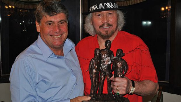 Moreton Bay Mayor Allan Sutherland and Barry Gibb  with a rough miniature of the statue to be unveiled on Thursday.