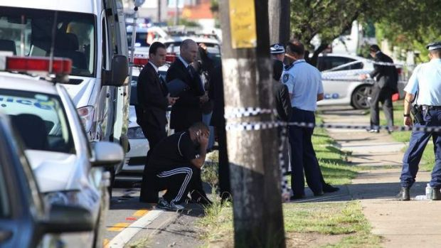 Police at the scene ... a body was found in a Bankstown home.
