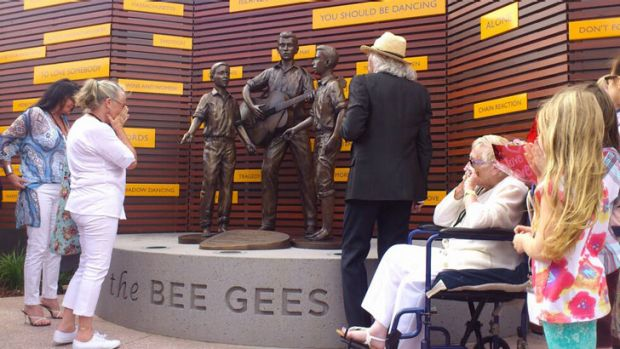 Barry Gibb with the statue of he and his brothers unveiled in Redcliffe today.