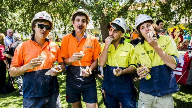 Brad Bromwich, Corey Shattos, Peter Hunt and Sheridan Godfrey enjoy their sausages at the CPSU and CFMEU organised BBQ ...
