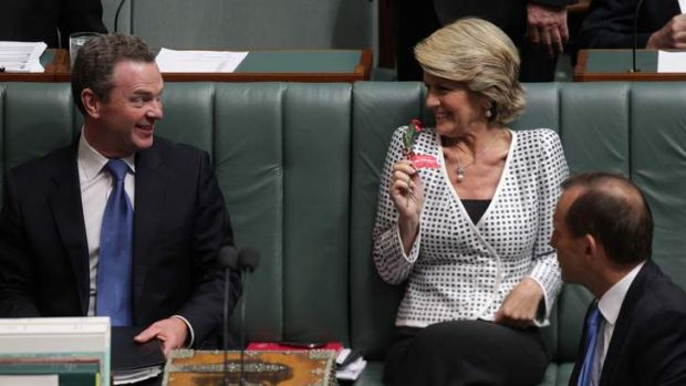 How sweet it is … the Deputy Opposition Leader, Julie Bishop, shows her chocolate rose to Christopher Pyne as Tony ...