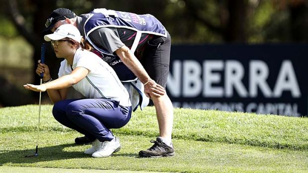 School's in ... New Zealander Lydia Ko lines up a putt during her astonishing first round.