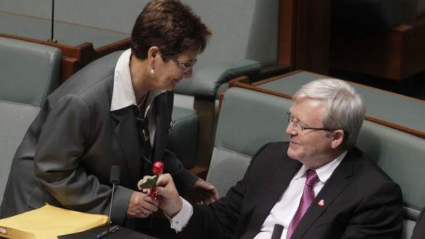 A Parliamentary attendant delivers a Valentines Day chocolate rose from the Opposition to ALP backbencher Kevin Rudd.
