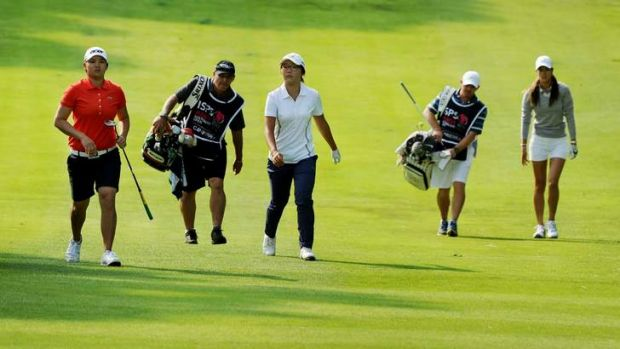 Yani Tseng, Lydia Ko and  Michelle Wie make their way up the 10th on Thursday.