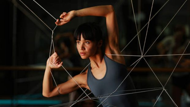 Stretching the limits … dancer Charmene Yap uses a web of elastic to devise new moves.