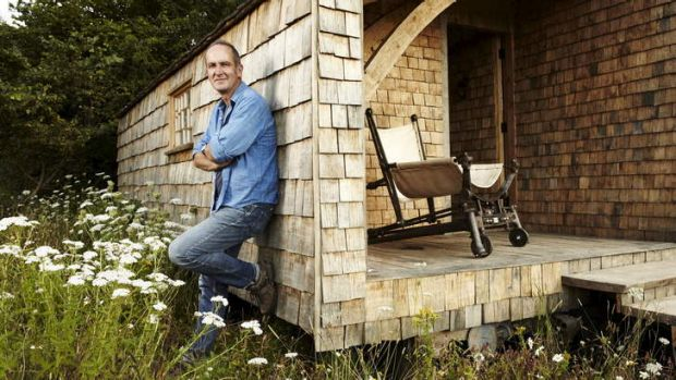Self-made man … Kevin McCloud shows off his sustainably built cabin.
