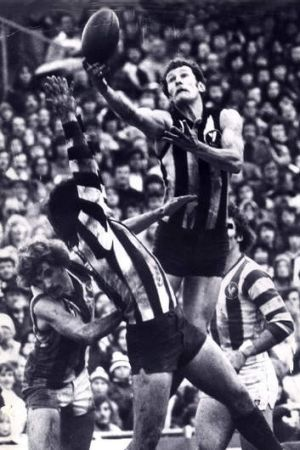 Flying high: Phil Carman soars above the rest to take a mark against North Melbourne in 1977.
