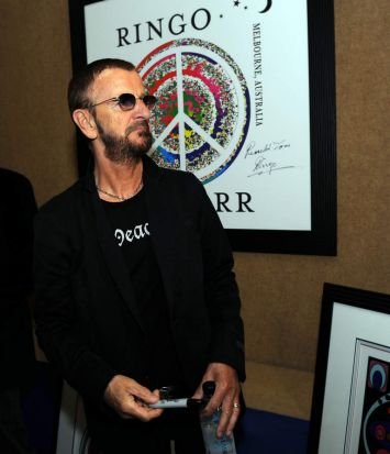 Ringo looks over some of his art work on display.