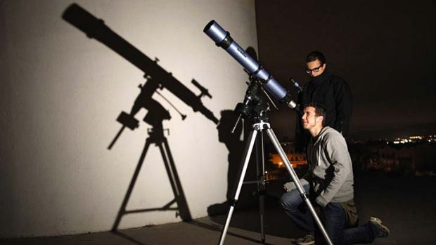 Students of the Astronomical Association of Sabadell prepare to watch Asteroid 2012 DA14 pass Earth, in Sabadell, Spain.