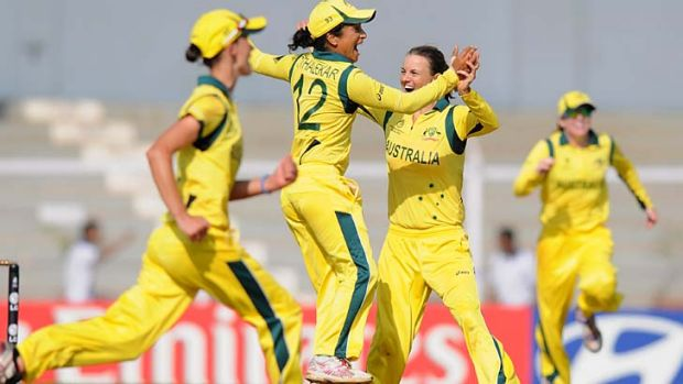 Going strong … Lisa Sthalekar, centre, celebrates with Erin Osborne after beating England in the World Cup.