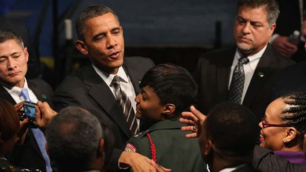 Warm welcome ... Barack Obama meets students at Hyde Park Academy High School in Chicago.