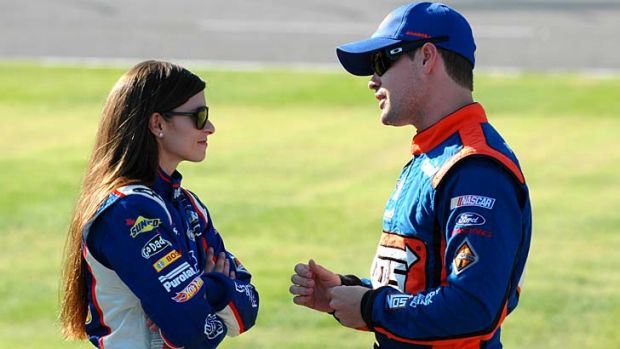 Driver Danica Patrick talks to Ricky Stenhouse in November 2012.