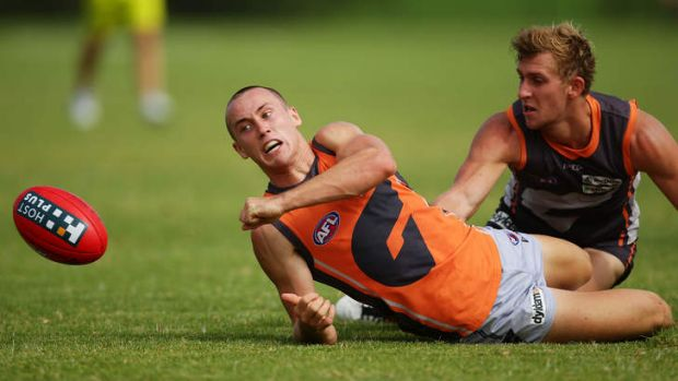 Tom Scully is tackled by Jonathan O'Rourke during the Giants' intra-club match on Saturday.