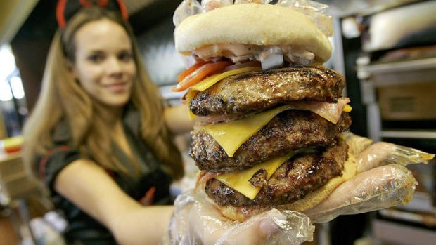 Calorific ... a waitress holds one of the  Heart Attack Grill's triple-bypass burgers.