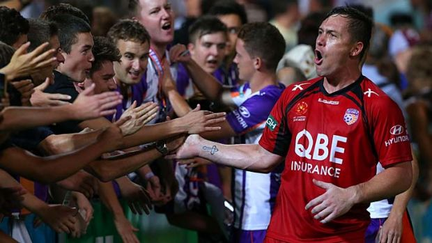 Triumph … Danny Vukovic celebrates after the win.