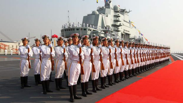 """Military officers stand onboard China's aircraft carrier """"Liaoning"""" in Dalian, northeast China's Liaoning Province, ..."""
