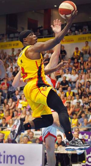 Two points: Jonny Flynn scores for Melbourne Tigers against Perth.