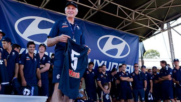 Bring it on: Mick Malthouse addresses the Carlton faithful at Visy Park on Sunday.