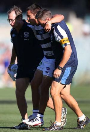 Geelong's Mathew Stokes is carried off with a leg injury during the game against West Coast on Saturday.