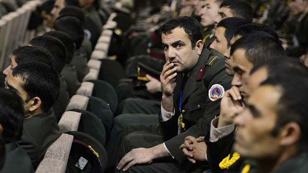 Defenders of the soil … Afghan National Army officers listen to the new policies on Taliban engagement and torture ...