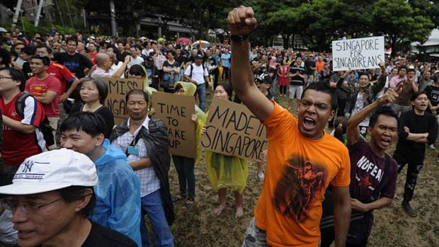 Worst off ... Singaporeans protest against a plan to increase its island population to 6.9 million by 2030 through ...
