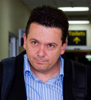 """Very relieved"" ... Senator Nick Xenophon arrives at Tullamarine Airport after being deported from Malaysia."