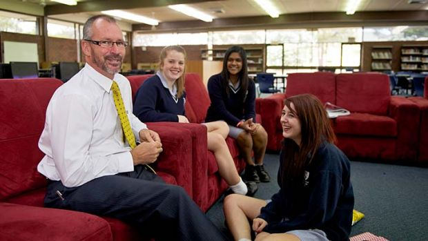 Classy approach: Templestowe principal Peter Hutton in the resource centre with Sarah Fraser (left), Semira Vandayar and ...