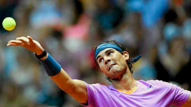 Comeback success ... Rafael Nadal serves to Argentina's David Nalbandian.