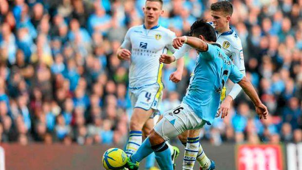 Sergio Aguero of Manchester City scores his second goal.