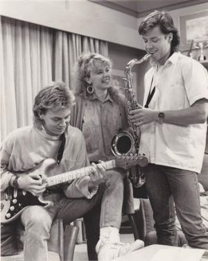 Kylie Minogue, Jason Donovan and Guy Pearce on the set of <i>Neighbours</i>.