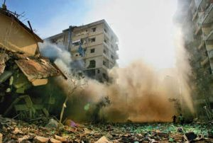Urban warfare … an apartment building in Beirut's southern suburbs collapses in the wake of an Israeli bomb.