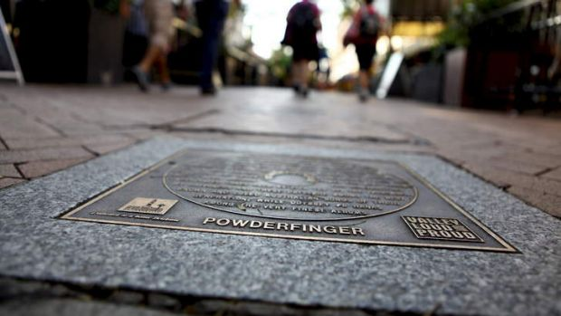 Powderfinger's plaque on the Brisbane music hall for fame in the Brunswick Street Mall pavers.