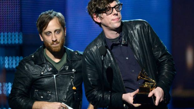 Black Keys' Dan Auerbach, left, and Patrick Carney accepting best rock performance for <i>Lonely Boy</i> at the Grammys.