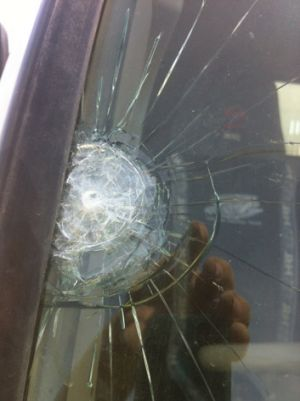 Costly ... The front windscreen of Mr North's work truck was shattered in January.