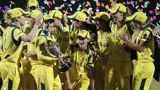 Champions ... Australia celebrate with the trophy after winning the ICC Women's cricket World Cup in Mumbai.
