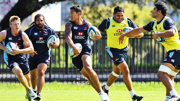 """''Obviously when he touches the ball, he's pretty handy"""" ... Ewen McKenzie on Israel Folau."""
