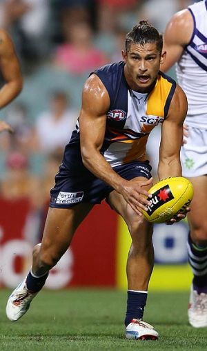 Sharrod Wellingham - questionable hairdo for the NAB Cup, even worse trampoline skills.