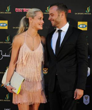 Oscar Pistorius with girlfriend Reeva Steenkamp, who was killed in their home.