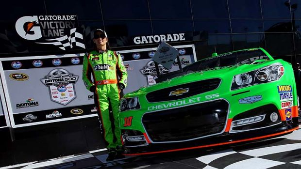 Danica Patrick poses for the media after she won the pole award for the NASCAR Sprint Cup Series Daytona 500.